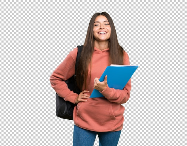 Young student woman holding notebooks posing with arms at hip and smiling Premium Psd