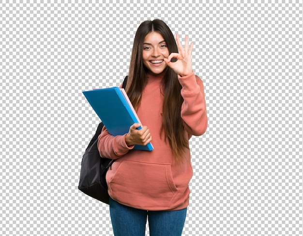 Young student woman holding notebooks showing ok sign with fingers Premium Psd