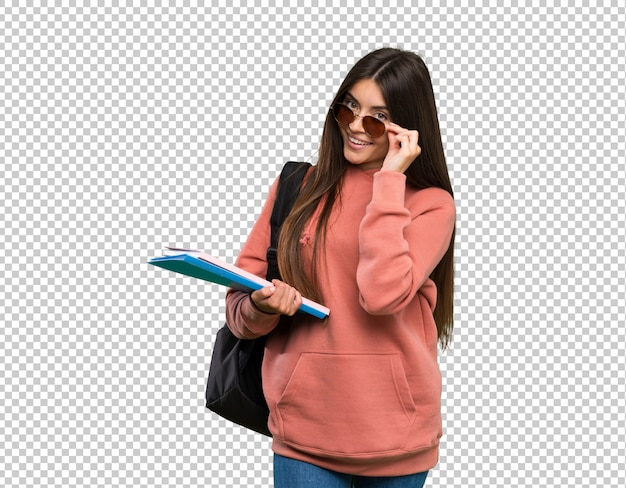 Young student woman holding notebooks with glasses and happy Premium Psd