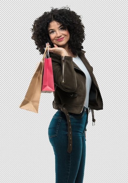 Young woman holding shopping bags Premium Psd