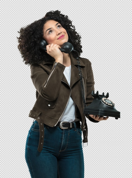 Young woman holding a telephone Premium Psd