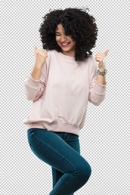 Young woman laughing and doing winner gesture Premium Psd