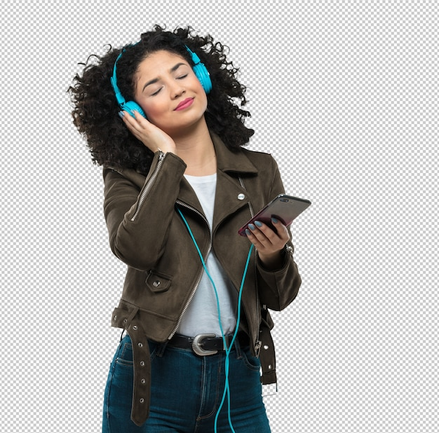 Young woman listening to music Premium Psd