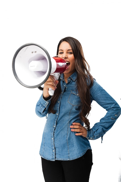 Young woman shouting with a megaphone Free Psd