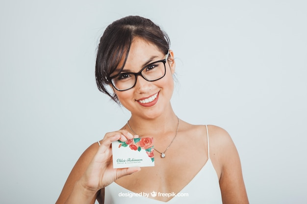 Young woman with business card's mock up Free Psd