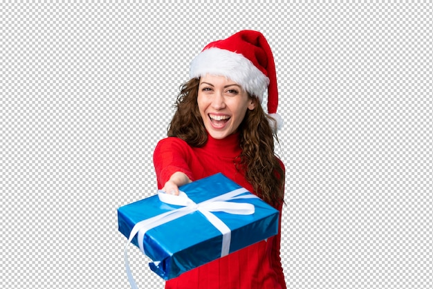 Young woman with christmas hat Premium Psd