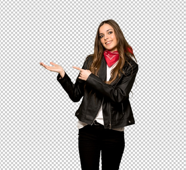 Young woman with leather jacket holding copyspace imaginary on the palm to insert an ad Premium Psd