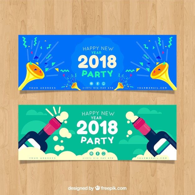 2018 party banners with trumpets and champagne Free Vector