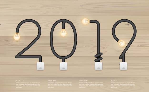 2019 - abstract light bulb on wood background. Premium Vector
