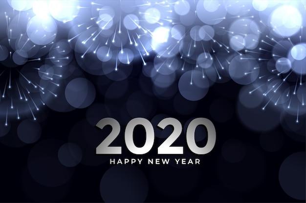 2020 new year firework glowing bokeh greeting card design Free Vector