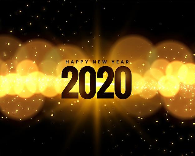 黄金のボケライトで2020年の新年のお祝い 無料ベクター