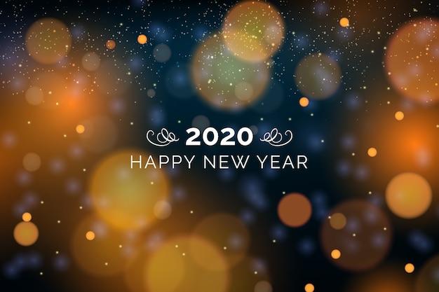 新年の2020年の背景がぼやけ 無料ベクター