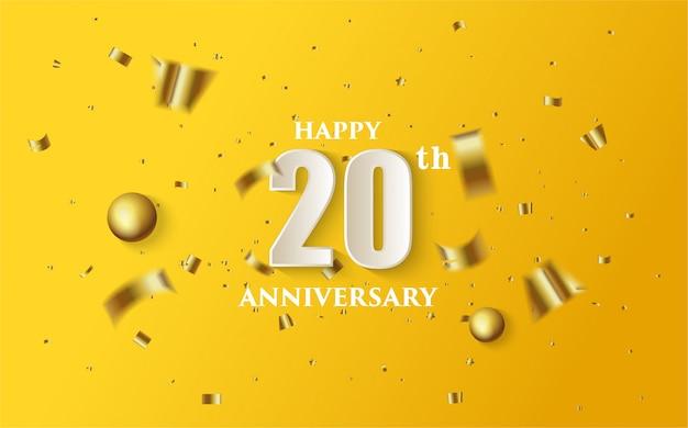 白い数字と黄色の背景に金のフォリオのイラストで20周年。 Premiumベクター