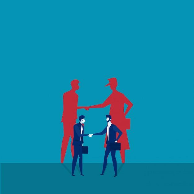 影で握手する2人のビジネスマン Premiumベクター