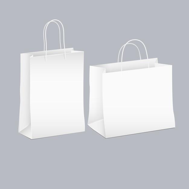 2つの白い空のショッピング紙袋のベクトルを設定 Premiumベクター