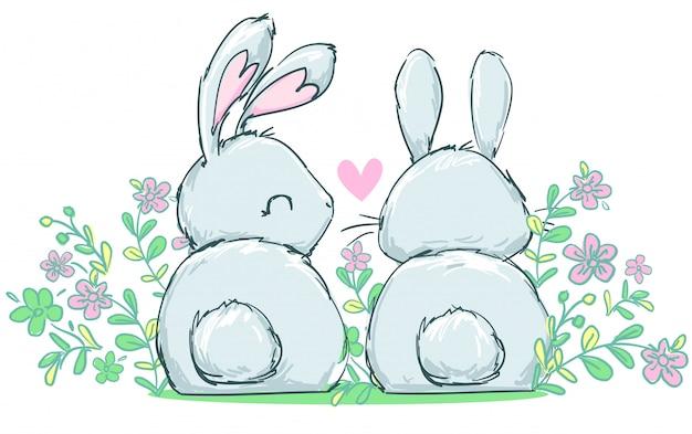 2 милых кролика сидя в цветках, иллюстрация детей красивая. Premium векторы