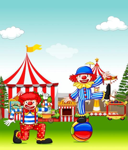 遊園地でパフォーマンスする2人のジェスター 無料ベクター