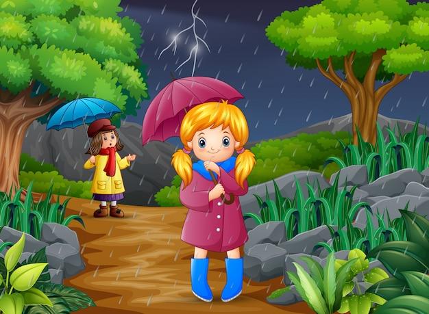 傘を運んでいる漫画の2人の少女 Premiumベクター