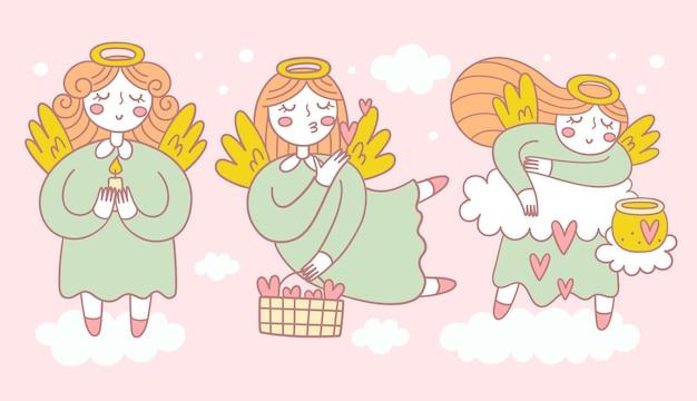 さまざまなポーズの3人のかわいい天使のコレクション Premiumベクター