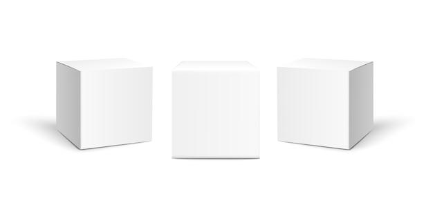 白い背景に分離された3つの正方形の紙箱。 Premiumベクター