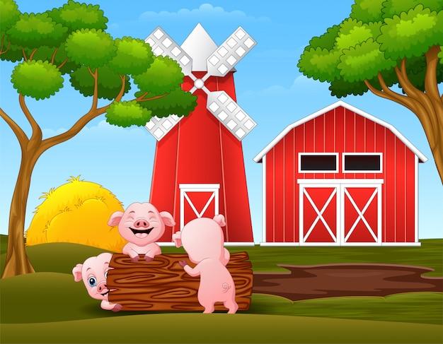 幸せな3匹の子豚が農場でログを再生 Premiumベクター