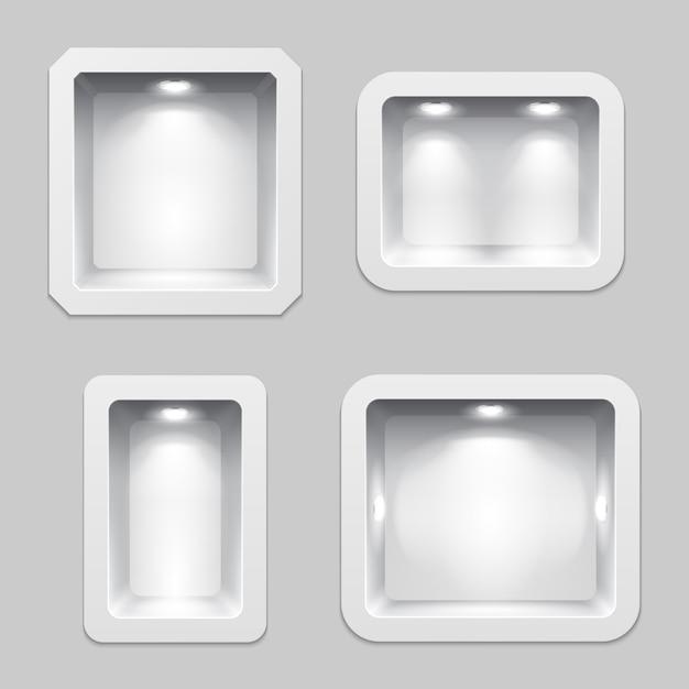 空の白いプラスチック製の箱または隙間のあるディスプレイ、照明付きの3次元展示品の棚。 Premiumベクター