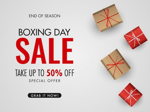 Афиша или баннер для продажи подарков на день подарков со скидкой 50% и подарочными коробками сверху на белом Premium векторы
