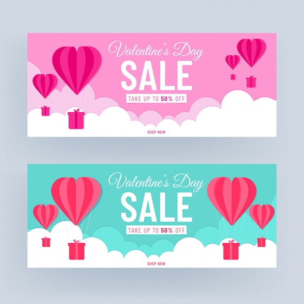 ピンクとターコイズブルーのヘッダーまたはバナーデザイン50%割引オファーとバレンタインセールの曇り背景にハート型の熱気球をカット紙。 Premiumベクター