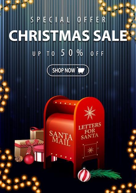 スペシャルオファー、クリスマスセール、最大50%オフ、プレゼント付きサンタレターボックス付きの垂直の濃い青の割引バナー Premiumベクター