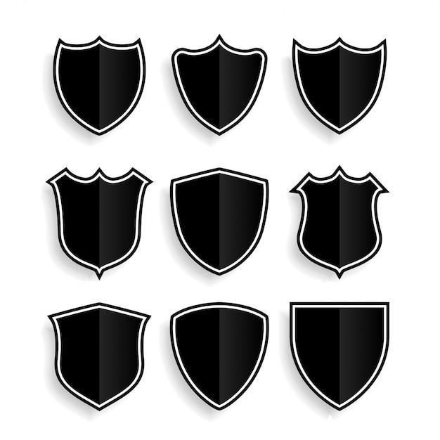 9つの盾のシンボルまたはバッジセット 無料ベクター