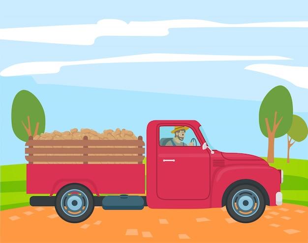 トランクでジャガイモとトラックを運転する農夫 Premiumベクター