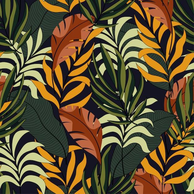 Модные тропические бесшовные модели с ярко-желтыми и зелеными листьями Premium векторы