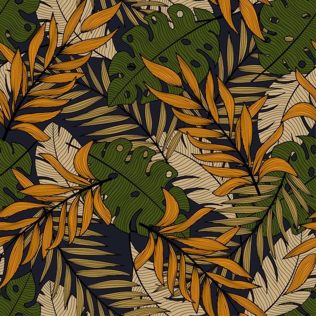 Абстрактный тропический бесшовный узор с красивыми зелеными и оранжевыми листьями и растениями Premium векторы