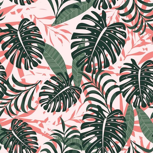 夏のトレンドの明るい熱帯の葉と植物のシームレス背景 Premiumベクター