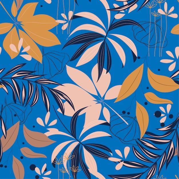 カラフルな熱帯の葉と青い背景上の植物で夏の明るいシームレスパターン Premiumベクター