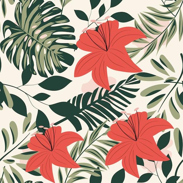 カラフルな熱帯の葉とパステル調の背景に植物夏の明るいシームレスパターン Premiumベクター