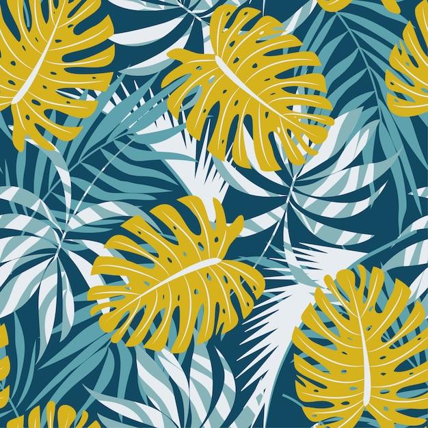 カラフルな熱帯の葉と青い背景の植物の元の抽象的なシームレスパターン Premiumベクター