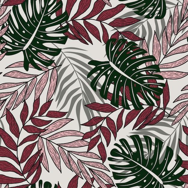 カラフルな熱帯の葉と繊細な背景の植物と抽象的なシームレスパターン Premiumベクター