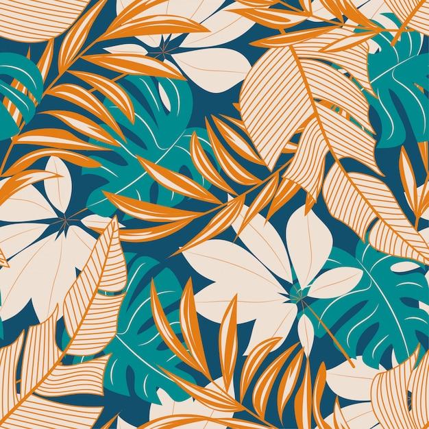 カラフルな熱帯の葉と花の抽象的なシームレスパターン Premiumベクター
