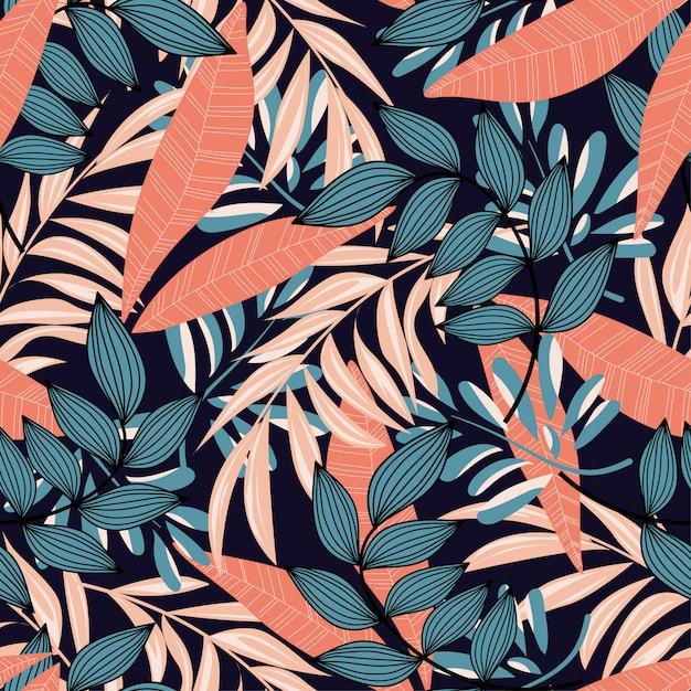 Тенденции абстрактный бесшовные модели с разноцветными тропическими листьями и растениями на синем фоне Premium векторы