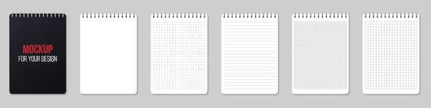 Тетради выложены и точки бумаги пустые страницы. Premium векторы