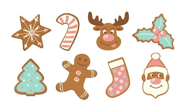 クリスマスのかわいいジンジャーブレッドクッキーのセット。 Premiumベクター