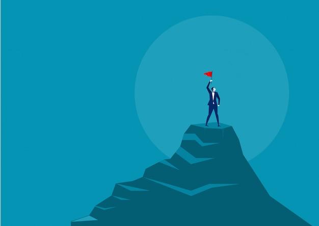 赤い旗を押しながら山の頂上に立っている実業家 Premiumベクター