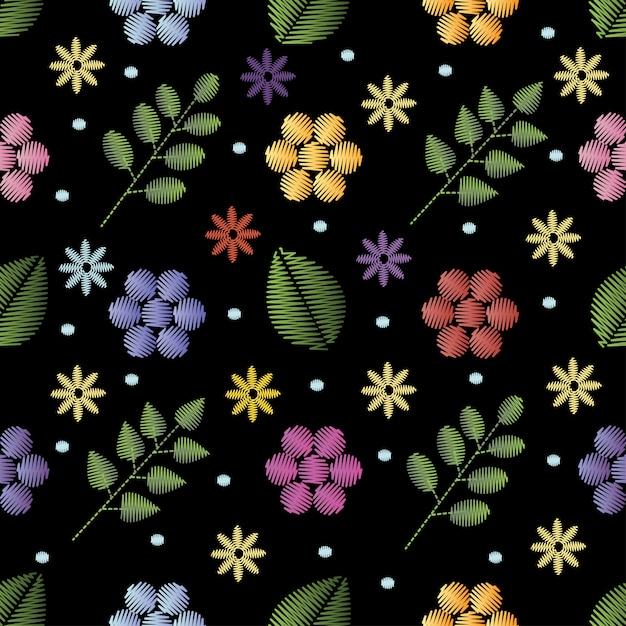 花と刺繍のシームレスなパターン。 Premiumベクター
