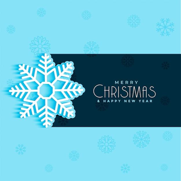青の背景にクリスマスの雪片のデザイン 無料ベクター