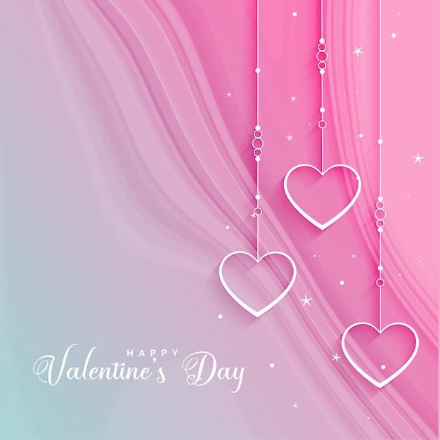 Красивое приветствие дня святого валентина с висящими сердцами Бесплатные векторы