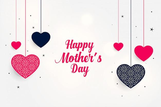 Прекрасное приветствие ко дню матери с висящими сердцами Бесплатные векторы