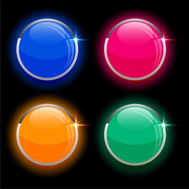Круглые кружочки блестящих стеклянных кнопок в четырех цветах Бесплатные векторы