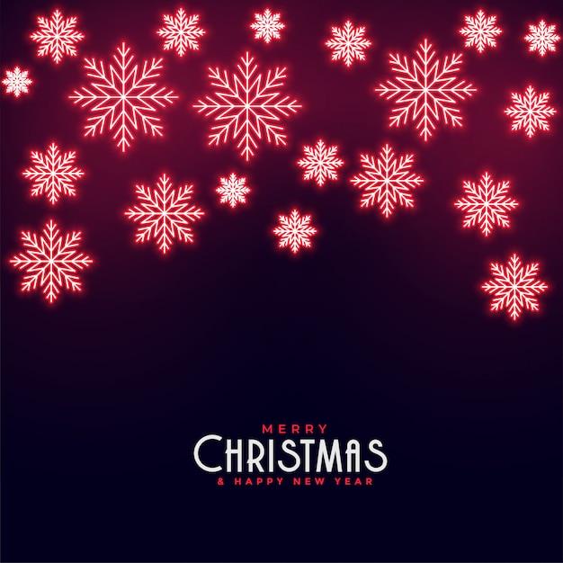 Красивые красные неоновые падающие снежинки новогодний фон Бесплатные векторы