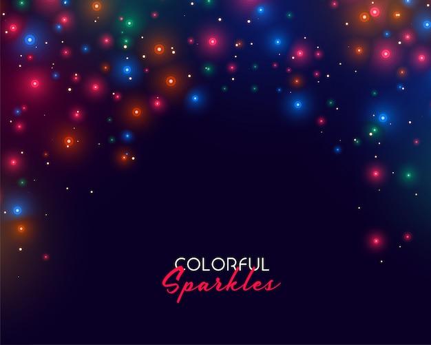 Разноцветные неоновые блестки на темном фоне Бесплатные векторы